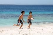 <h5>Kids having a ball on the beach - Te Amo Bonaire</h5>