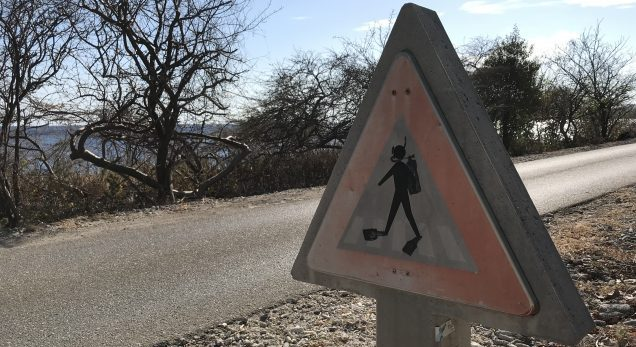 danger divers crossing the road