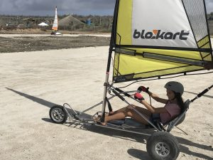 child getting ready to go land sailing on a blokart bonaire