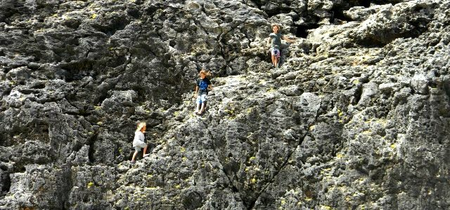kids climbing on rocks in Slagbaai National Park Bonaire