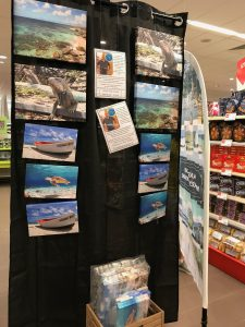 photos sold at the grocery store with island scenes
